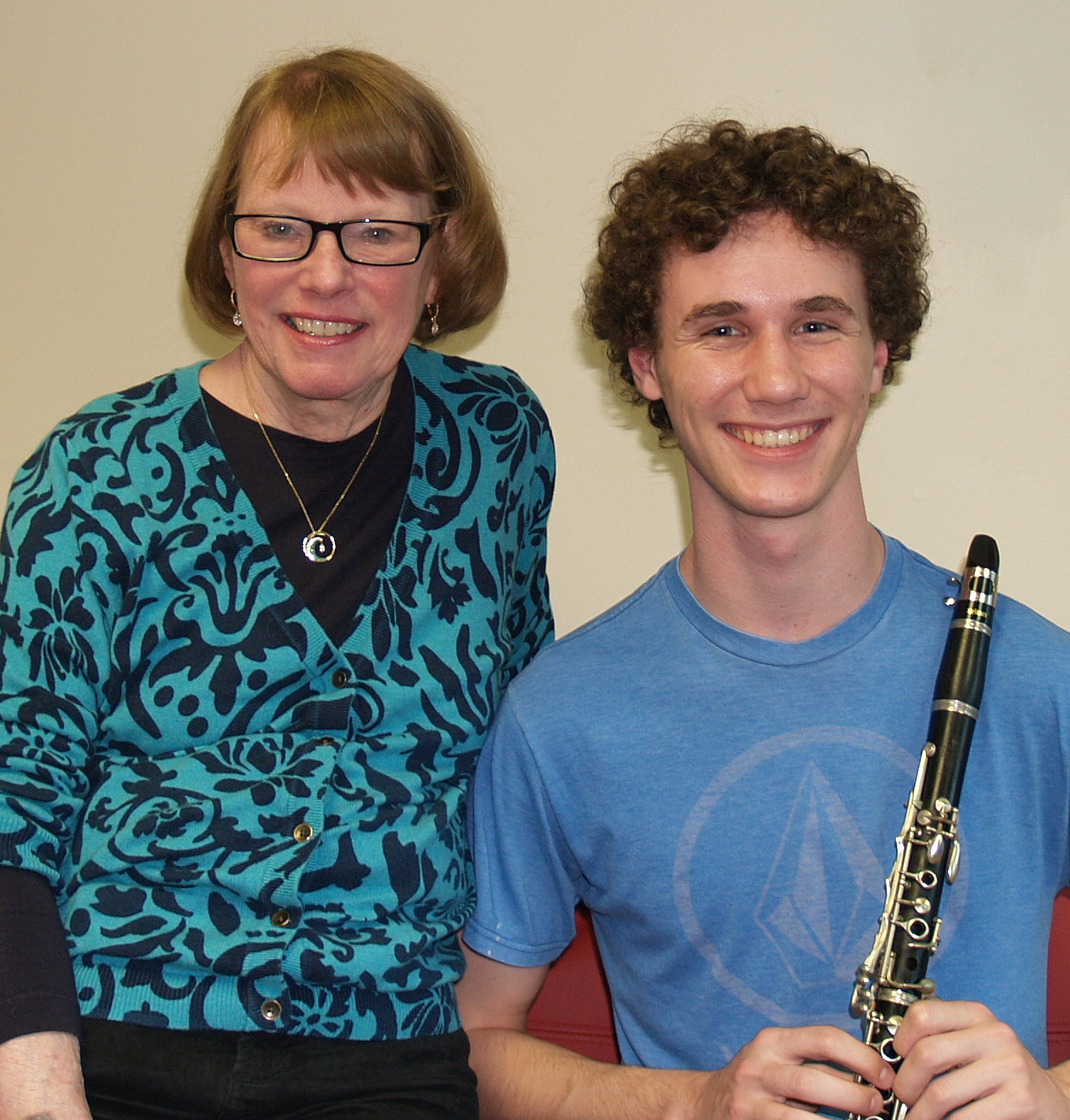 Jonathan Salman receives a clarinet from Instrument Match chair Leslie Barger